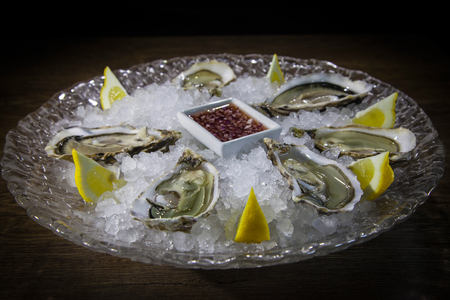 Kiev, Ukraine - February 26, 2018: Oysters on ice in a transparent plate. 写真素材