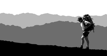 grayscale: Man with a backpack going up the hill. mountains in the background