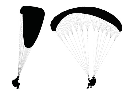 paragliding: Silhouettes of flying paragliders