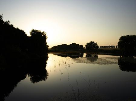 Sundown over river photo