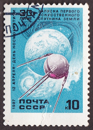 artificial satellite: USSR - CIRCA 1987  A post stamp printed in USSR shows  Sputnik 1  first Soviet  artificial satellite orbits Earth , circa 1987
