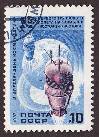 USSR - CIRCA 1987  A post stamp printed in USSR shows Soviet Vostok 3 and Vostok 4 space ships, circa 1987 photo