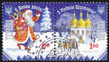 acirc: UKRAINE - CIRCA 2011  A post stamp printed in Ukraine shows St  Nicholas with the inscription in Ukrainian &  acirc,Happy New Year and Merry Christmas & acirc, circa 2011