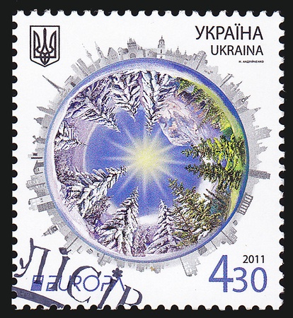acirc: UKRAINE - CIRCA 2011  A post stamp printed in Ukraine shows symbolic globe and trees, with inscription  Europa &acirc, International Year of Forests 2011 , circa 2011
