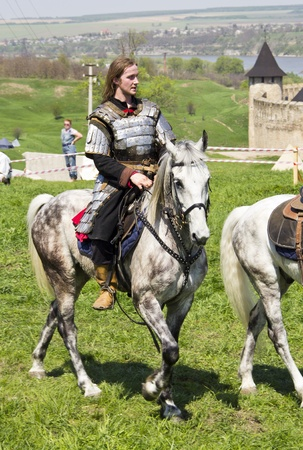 KHOTYN - APRIL 30: Knight in armor riding onhorseback - Medieval Khotyn Festival. April 30, 2012. Khotyn. Ukraine