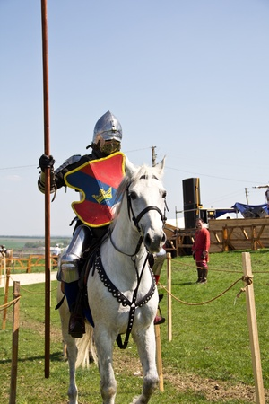 KHOTYN - APRIL 30: Knight in armor riding on�horseback - Medieval Khotyn Festival. April 30, 2012. Khotyn. Ukraine