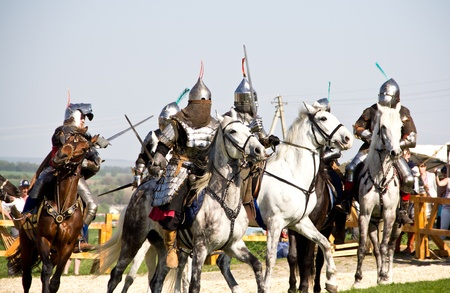 KHOTYN - APRIL 30: Group of� knights in armor fighting�with swords on�horseback - Medieval Khotyn Festival. April 30, 2012. Ukraine