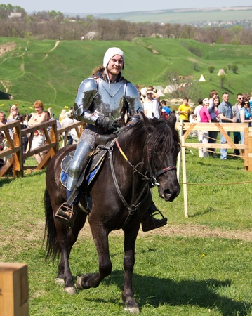 KHOTYN - APRIL 30: Knight in armor riding on horseback - Medieval Khotyn Festival. April 30, 2012. Khotyn. Ukraine