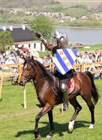 KHOTYN - APRIL 30: Knight in armor riding on�horseback - Medieval Khotyn Festival. April 30, 2012. Khotyn. Ukraine