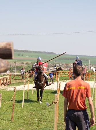 KHOTYN - APRIL 30: Knights fighting in tournament with lances  on horseback - Medieval Khotyn Festival. April 30, 2012. Ukraine