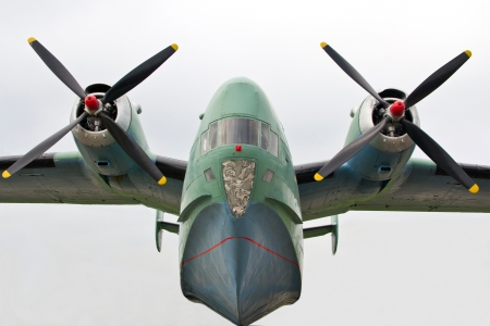 turboprop: Amphibious turboprop plane on takeoff on sky background Editorial