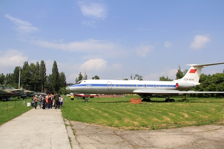 KIEV, UKRAINE- MAY 16: Group of people and  Tupolev Tu-134 at State Aviation Museum on  May 16, 2012 in Kiev, Ukraine Stock Photo - 13744235