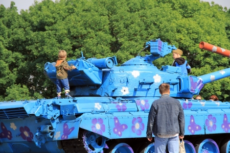 KIEV, UKRAINE- MAY 16: Hippie-painted tanks crossing barrels  in Museum of the Great Patriotic War  on  May 16, 2012 in Kiev, Ukraine