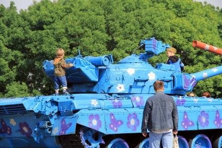 KIEV, UKRAINE- MAY 16: Hippie-painted tanks crossing barrels  in Museum of the Great Patriotic War  on  May 16, 2012 in Kiev, Ukraine