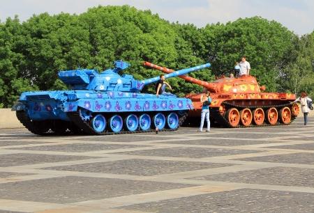 KIEV, UKRAINE- MAY 16: Hippie-painted tanks crossing barrels  in Museum of the Great Patriotic War  on  May 16, 2012 in Kiev, Ukraine Stock Photo - 13744232