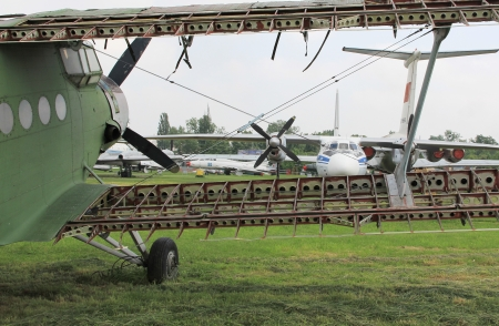 Old abandoned biplane on airfield