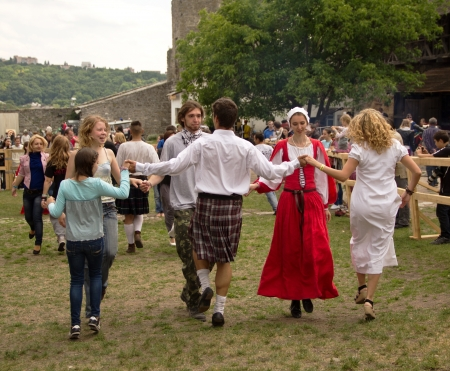 irish history: KAMYANETS-PODILSKY- JUNE 2: Young people dancing during Forpost (The Outpost) Festival of Medieval Culture on June 2, Ukraine Editorial