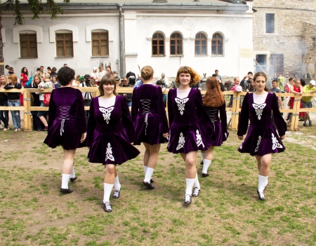 outpost: KAMYANETS-PODILSKY- JUNE 2: Dancing girls during Forpost (The Outpost) Festival of Medieval Culture on June 2, Ukraine