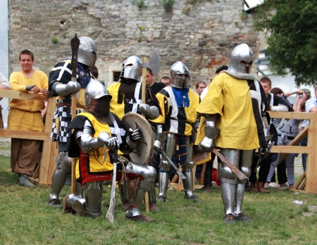 outpost: KAMYANETS-PODILSKY- JUNE 2: Knights in armor during Forpost (The Outpost) Festival of Medieval Culture on June 2, Ukraine Editorial