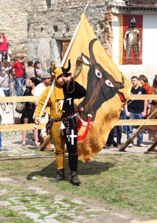 KAMYANETS-PODILSKY- JUNE 2: Team mascot with flag and horn during Forpost (The Outpost) Festival of Medieval Culture on June 2, Ukraine