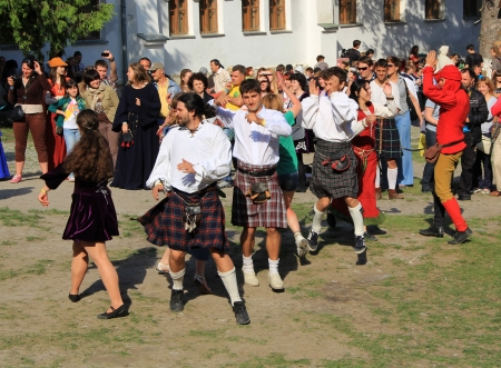 uncovering: KAMYANETS-PODILSKY- JUNE 2: Young people dancing during Forpost (The Outpost) Festival of Medieval Culture on June 2, Ukraine Editorial