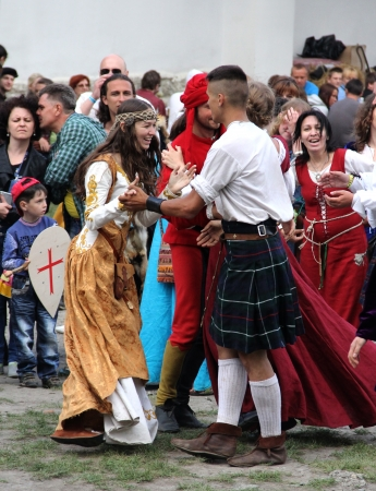 outpost: KAMYANETS-PODILSKY- JUNE 2: Young people dancing during Forpost (The Outpost) Festival of Medieval Culture on June 2, Ukraine Editorial