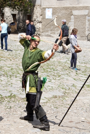 outpost: KAMYANETS-PODILSKY- JUNE 2: Shooting archer during Forpost (The Outpost) Festival of Medieval Culture on June 2, Ukraine Editorial