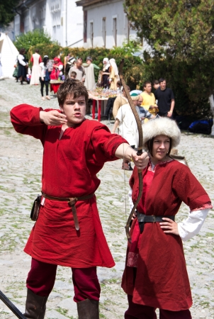 KAMYANETS-PODILSKY- JUNE 2: Shooting archer during Forpost (The Outpost) Festival of Medieval Culture on June 2, Ukraine