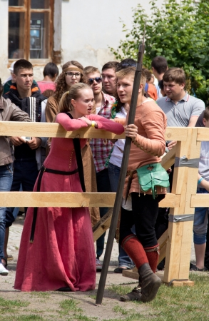 outpost: KAMYANETS-PODILSKY- JUNE 2: Young people  during Forpost (The Outpost) Festival of Medieval Culture on June 2, Ukraine