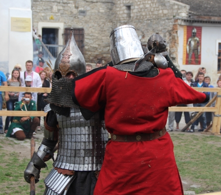 crusades: KAMYANETS-PODILSKY- JUNE 2: Knights battle during Forpost (The Outpost) Festival of Medieval Culture on June 2, Ukraine