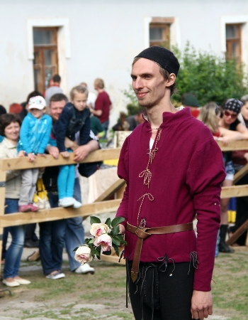KAMYANETS-PODILSKY- JUNE 2: Young man with roses during Forpost (The Outpost) Festival of Medieval Culture on June 2, Ukraine