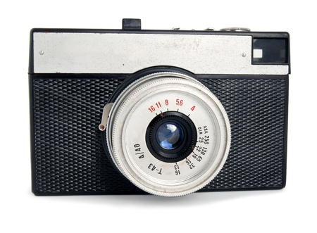 Old vintage entry-level camera isolated on white background photo