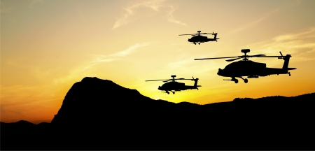 army background: Flying helicopter silhouettes on sunset background