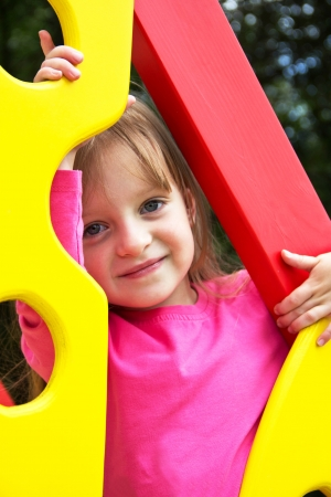 Cute smiling little girl  on playground posing  Portrait photo