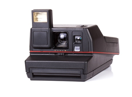 Old polaroid camera isolated on white background photo