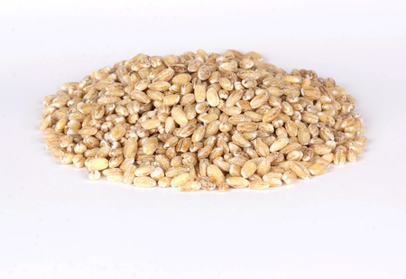 Pile of pearl barley isolated on white Stock Photo - 15329638