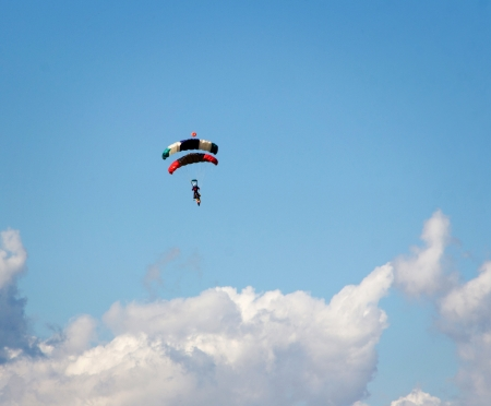 skydive: Skydivers in blue cloudy sky background