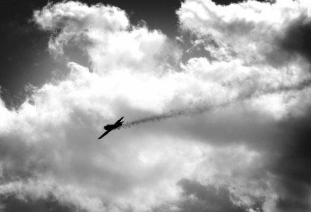 battle plane: WW2 fighter falling with smoke trail on dramatic sky background