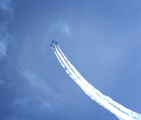acrobatic: Aircrafts with smoke trails flying on blue cloudy sky background