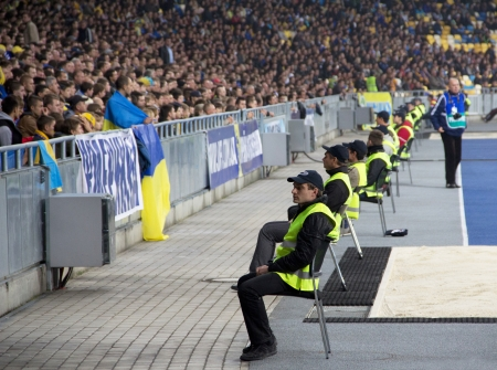 chear: KYIV, UKRAINE - OCTOBER 16: Unidentified spectators during  World Cup Qualifier Ukraine vs. Montenegro on October 16, 2012 in Olympiysky Stadium, Kyiv, Ukraine Editorial
