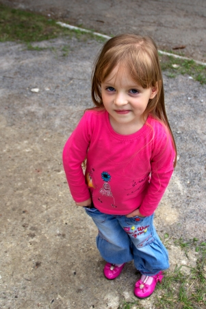 only girls: Funny smiling little girl posing  Close up Stock Photo