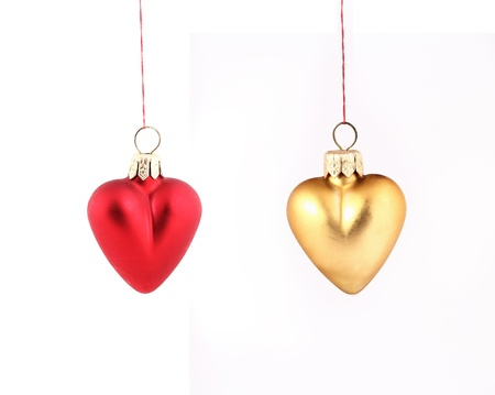 Hanging Christmas red and yellow hearts isolated on white background photo