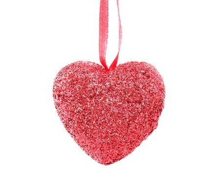 Hanging Christmas heart with silver beads  isolated on white background photo