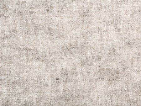 Beige fabric texture. Clothes background. Close up photo