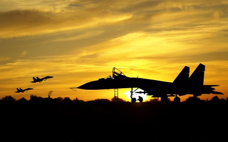fighter pilot: Military aircrafts silhouettes  on sunset background Stock Photo