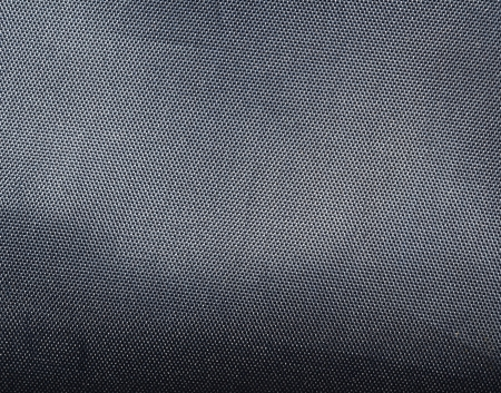 Black polyester texture background  Close up photo