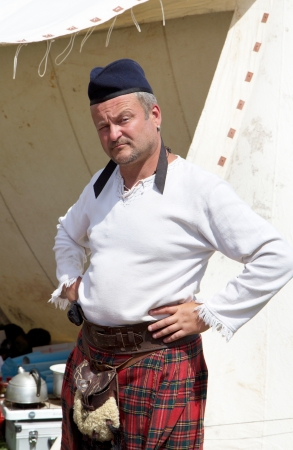 uncovering: KHOTYN - MAY 10: Unidentified Scottish man during Festival Medieval Khotyn on May 10, 2013, Ukraine