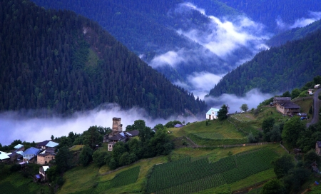 Mountain village with ancient towers on blue cloudy sky background Stock Photo - 21048991