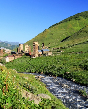 svan: Mountain village with ancient towers on blue sky background  Stock Photo