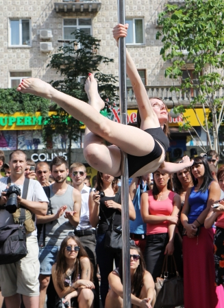 KIEV, UKRAINE - JUNE 30: Unidentified  pole dancer woman and spectators during Youth Day  in Kiev, Ukraine on June 30, 2013